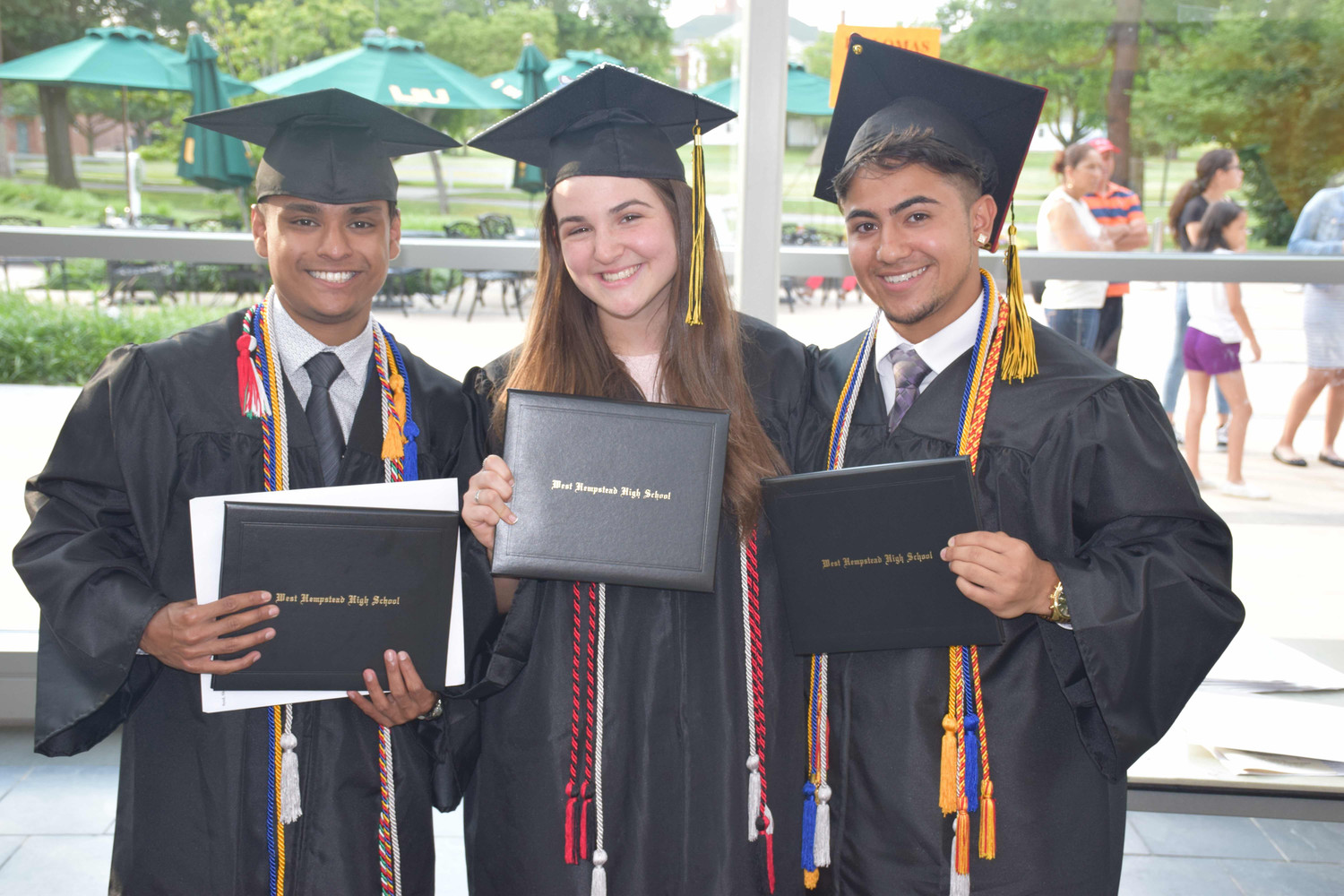 Valedictorian Shadman Syed, left, Class President Sydney Hoffman and salutatorian Lee Boodoo were among West Hempstead High School's class of 2018, whose graduation ceremony was held at LIU Post last Sunday.