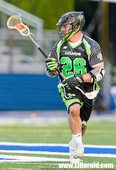 Newly acquired Tommy Kelly dominated faceoffs (26 of 37) to help the Lizards knock off first-place Charlotte, 20-16, on June 16.