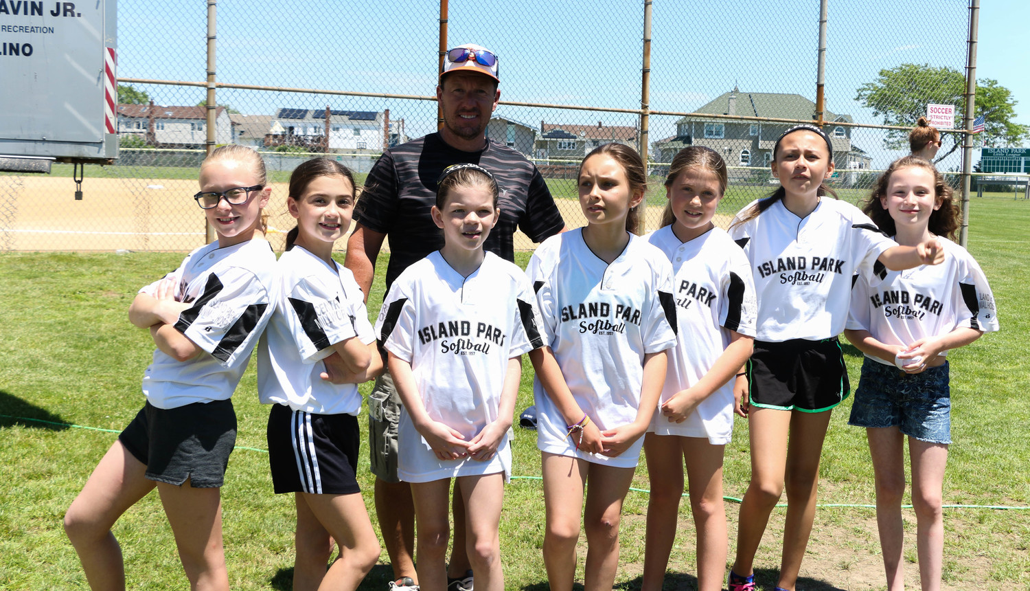 The Island Park Extreme softball team is one of 19 teams comprising the Island Park Little League. The players waited patiently for their well-earned trophies to be handed out at the annual Trophy Day on June 16 at Shell Creek Park.