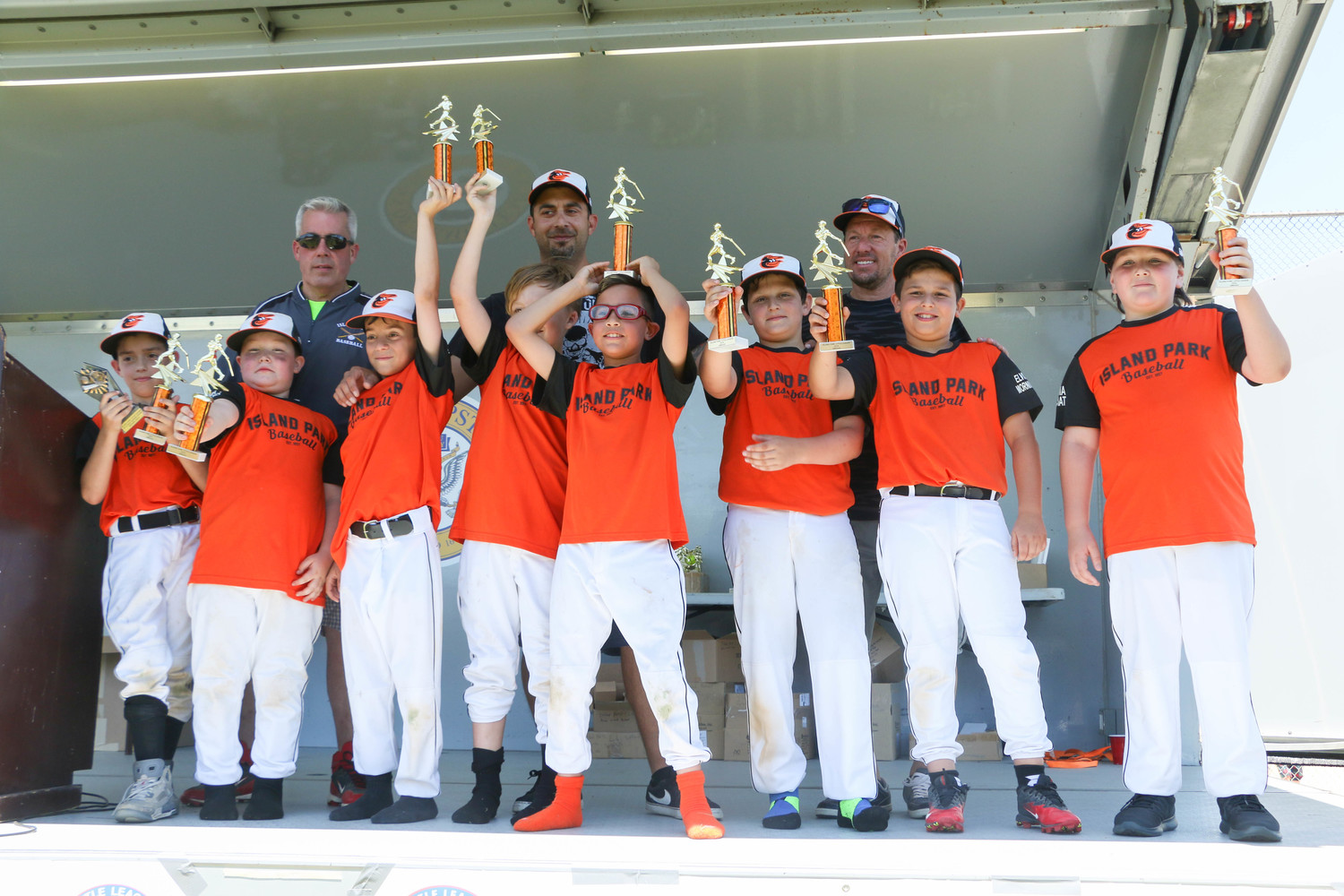 The younger kids from the Island Park Orioles baseball team were thrilled receiving their trophies.