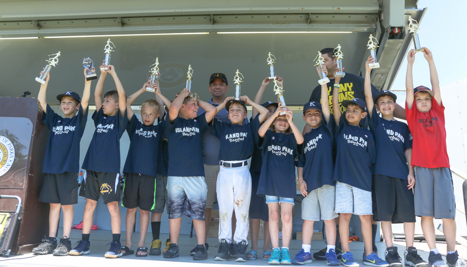 The Island Park Knights raised their trophies high in celebration.