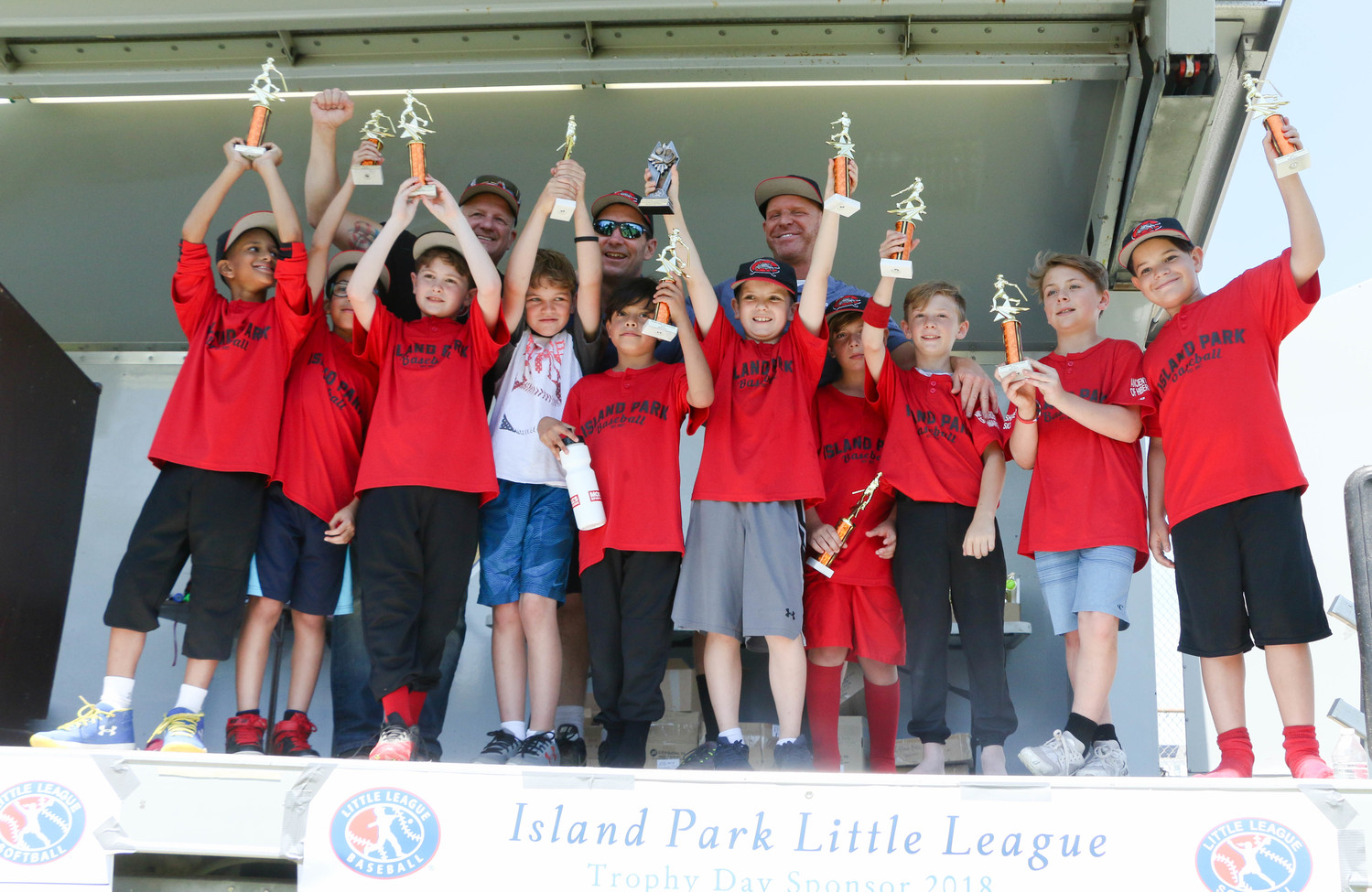 The Island Park Mudcats cheered altogether after they were given a bunch of trophies.