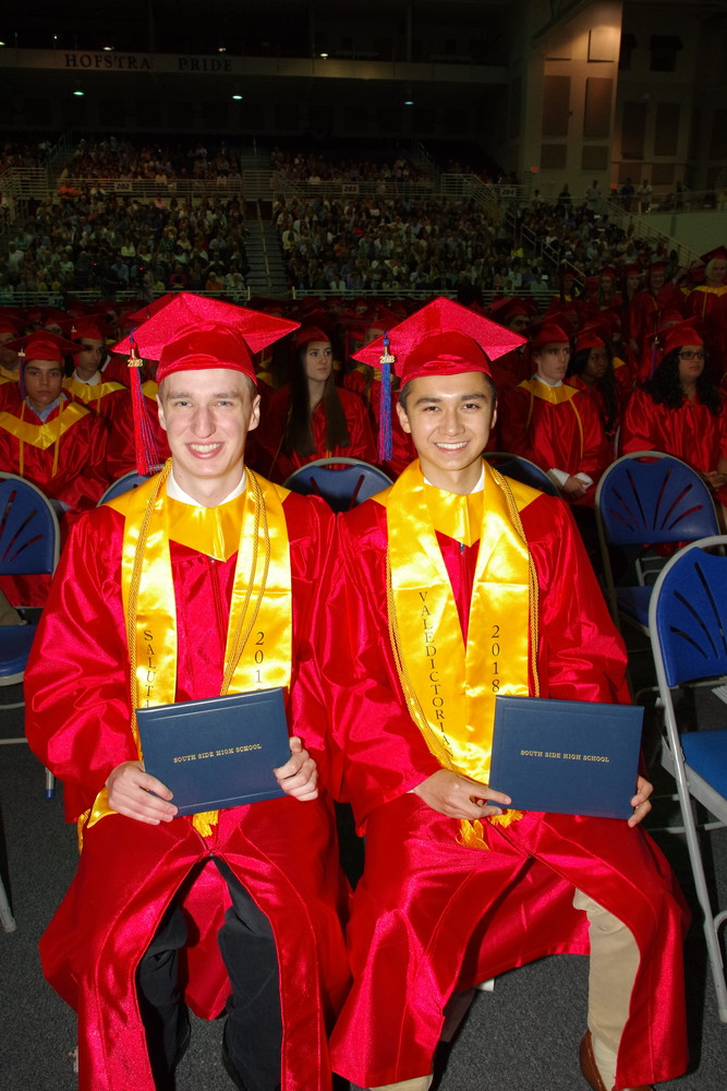 Salutatorian Peter Weiss, far left, and valedictorian Michael Luvin each addressed their fellow graduates.