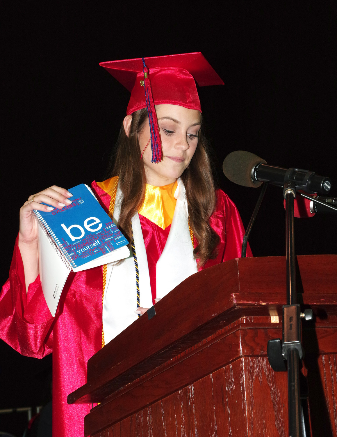 "Julia Lanzillotto took to the podium to share a quote from her ""Be Book,"" with her fellow graduates."