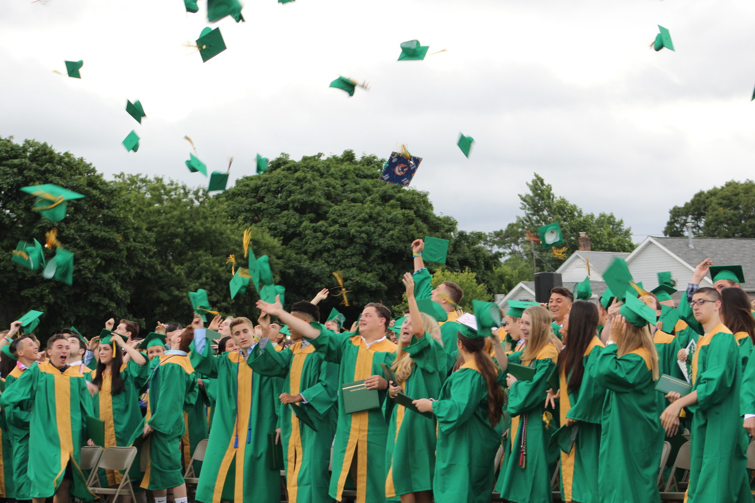 Lynbrook High School graduates tossed their mortarboards at the end of their commencement ceremony at the Marion Street football field last Friday.