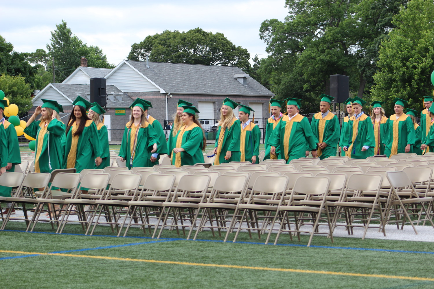 The senior class walked across the field at Marion Street School to take their seats at graduation on June 22.