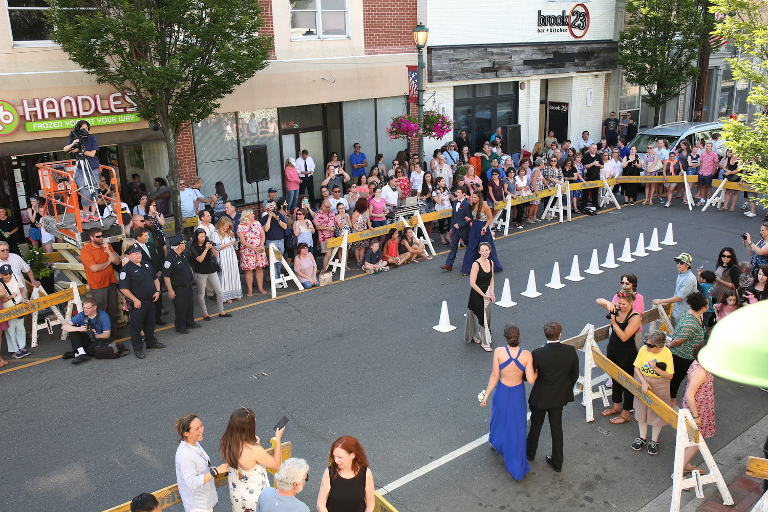 Hundreds of people flocked to Atlantic Avenue to watch Lynbrook High School seniors stroll down the parade route before prom.