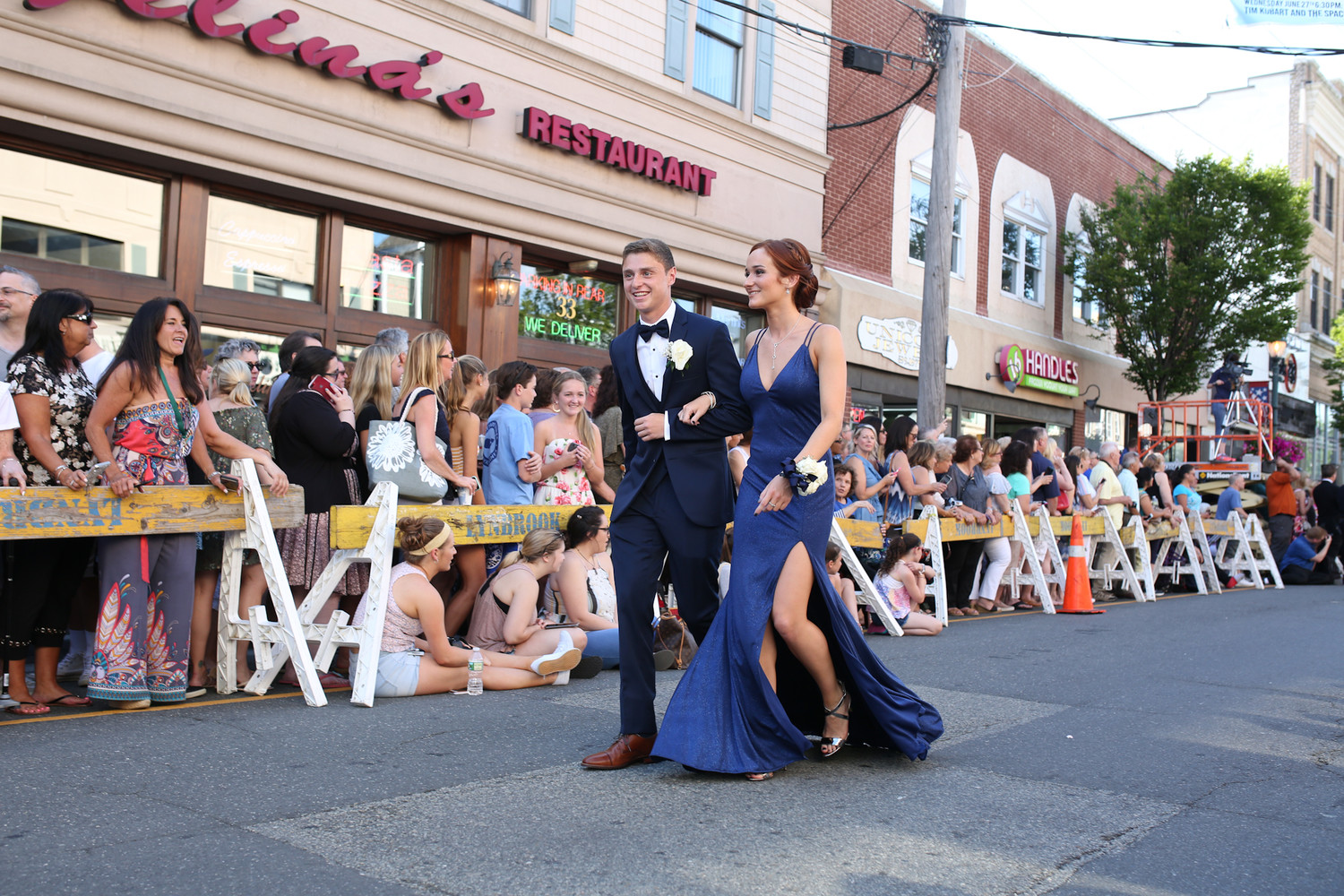 Seniors Michael Kantor and Sophia Sarnataro paraded down Atlantic Avenue as part of the village's annual pre-prom celebration.