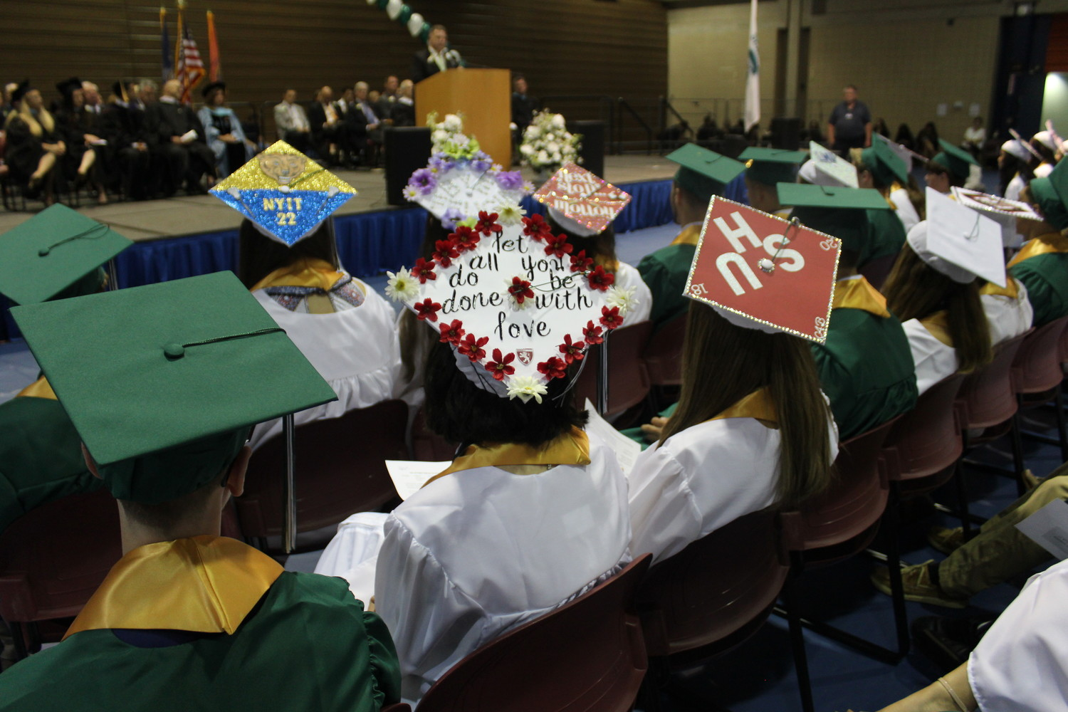 While some Seaford graduates kept their green hats pristine, others saw them as empty canvases or message boards.