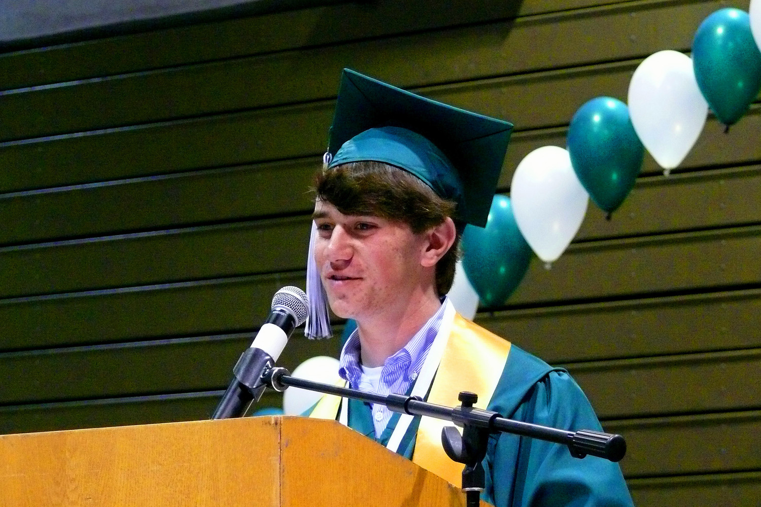 Valedictorian Jordan Ament told his fellow graduates to use the voices they developed in high school for good in the future.