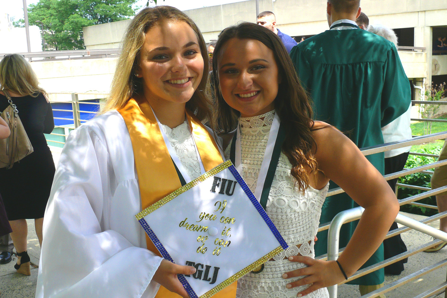 Mariah Hefferman, left, and Madison Anne Carollo were all smiles after graduating from Seaford High School.