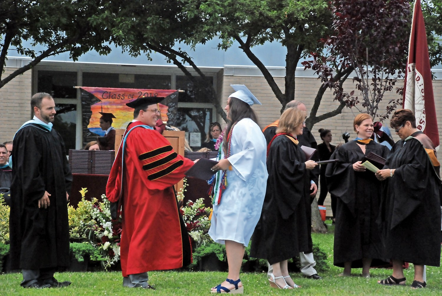 Lindsey Golden was congratulated by Superintendent Dr. Peter Giarrizzo after he presented her with her diploma.