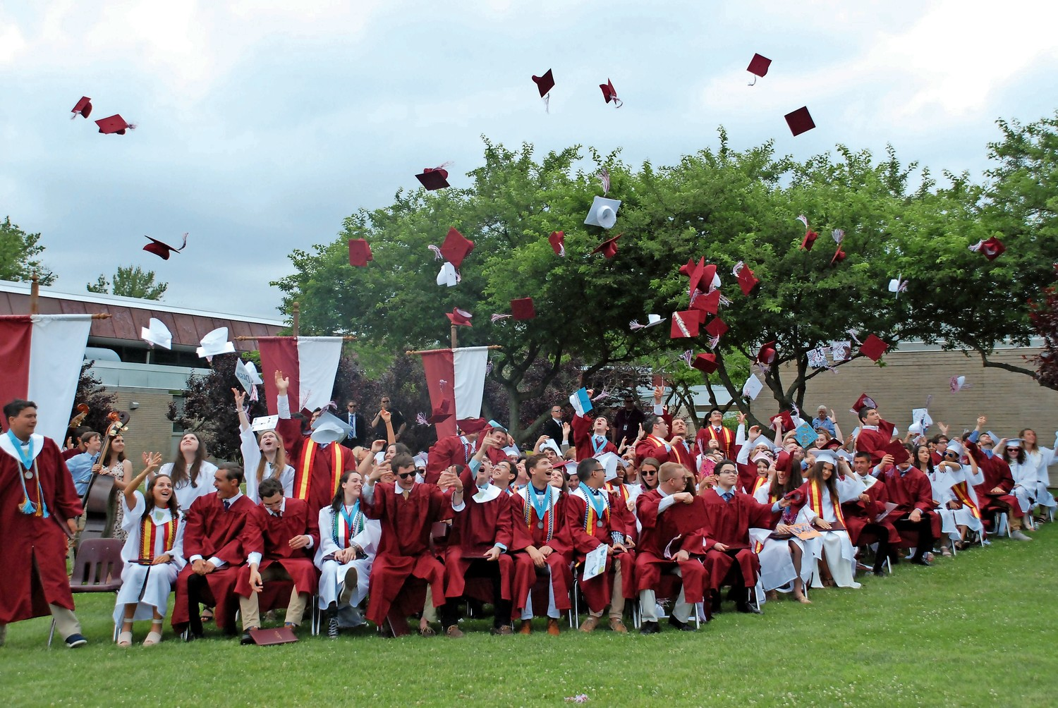 After they moved their tassels across their mortarboards, North Shore High's latest graduating class tossed the caps in the air, creating a cascade of maroon and white.