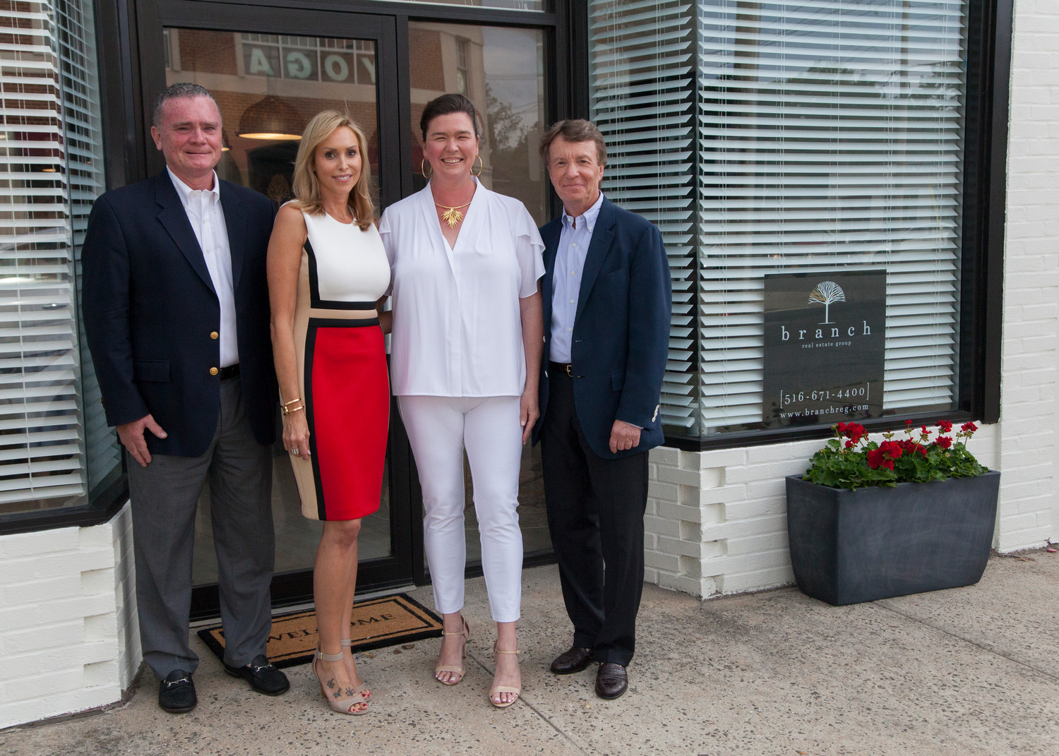 Branch Realty partners John Breen, left, Cristina Volz, Molly Deegan and Stephen Buerger outside their new offices on Glen Cove Avenue