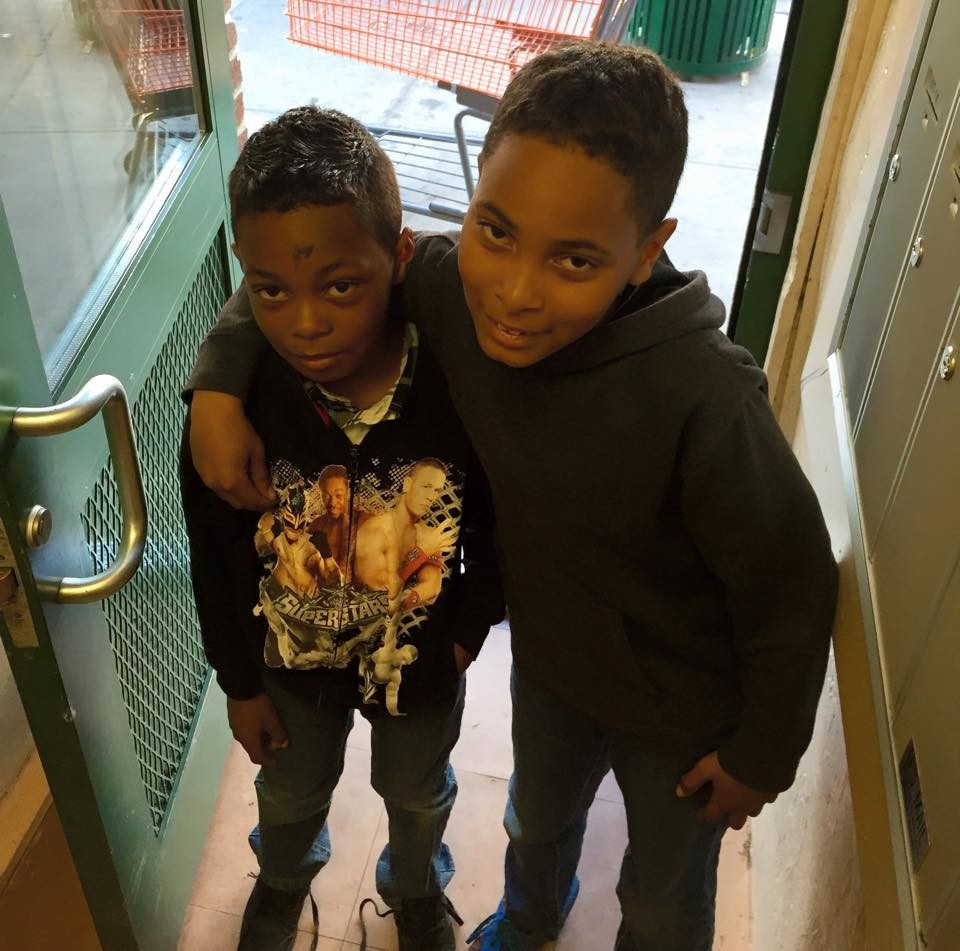 Ramell McRae Jr., left, with his brother Jaquan.
