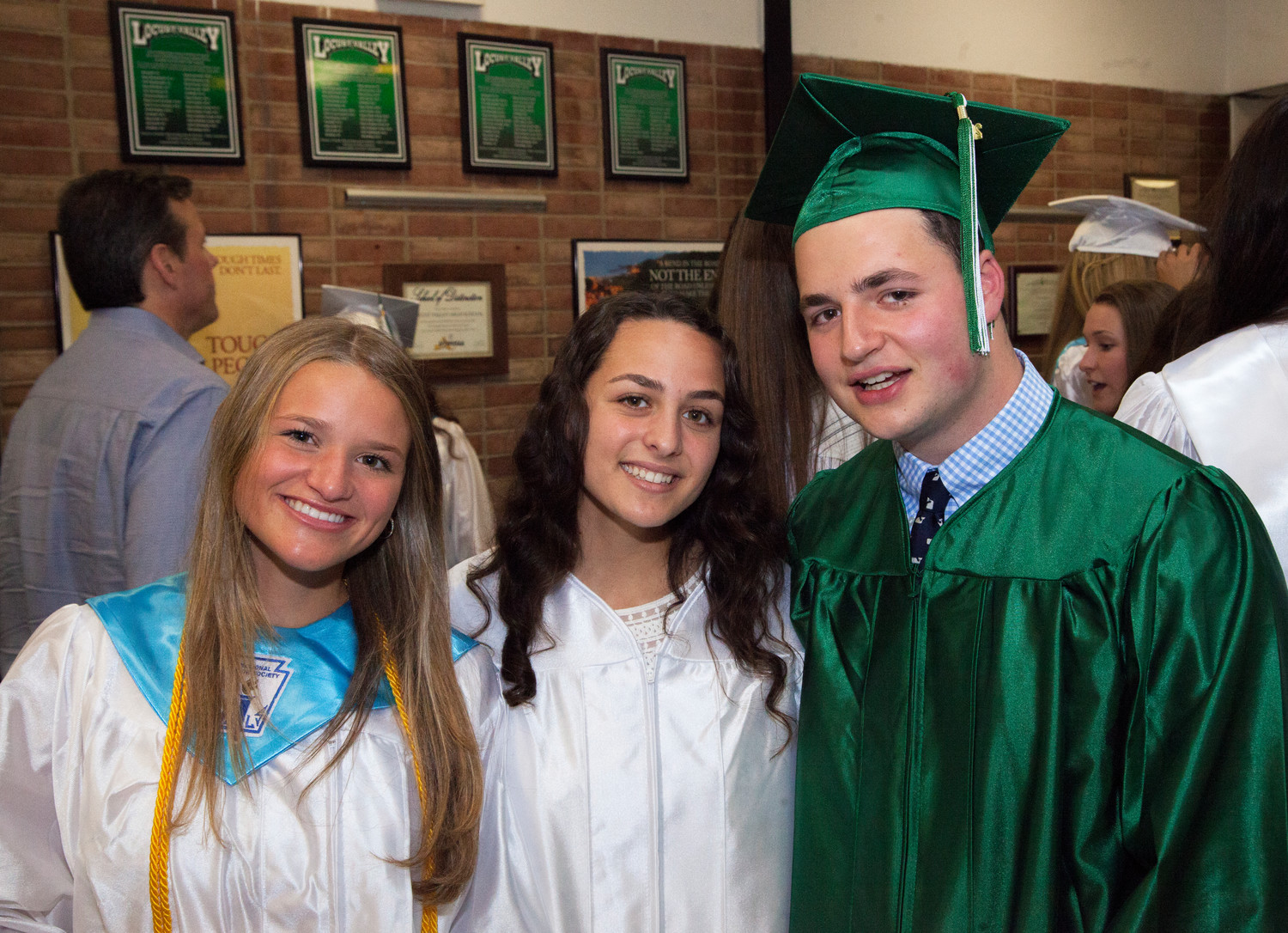 Graduates from far left, Carrie Willcochs, Guilianna Parisi and Harris Torossian savored the moment on Saturday.