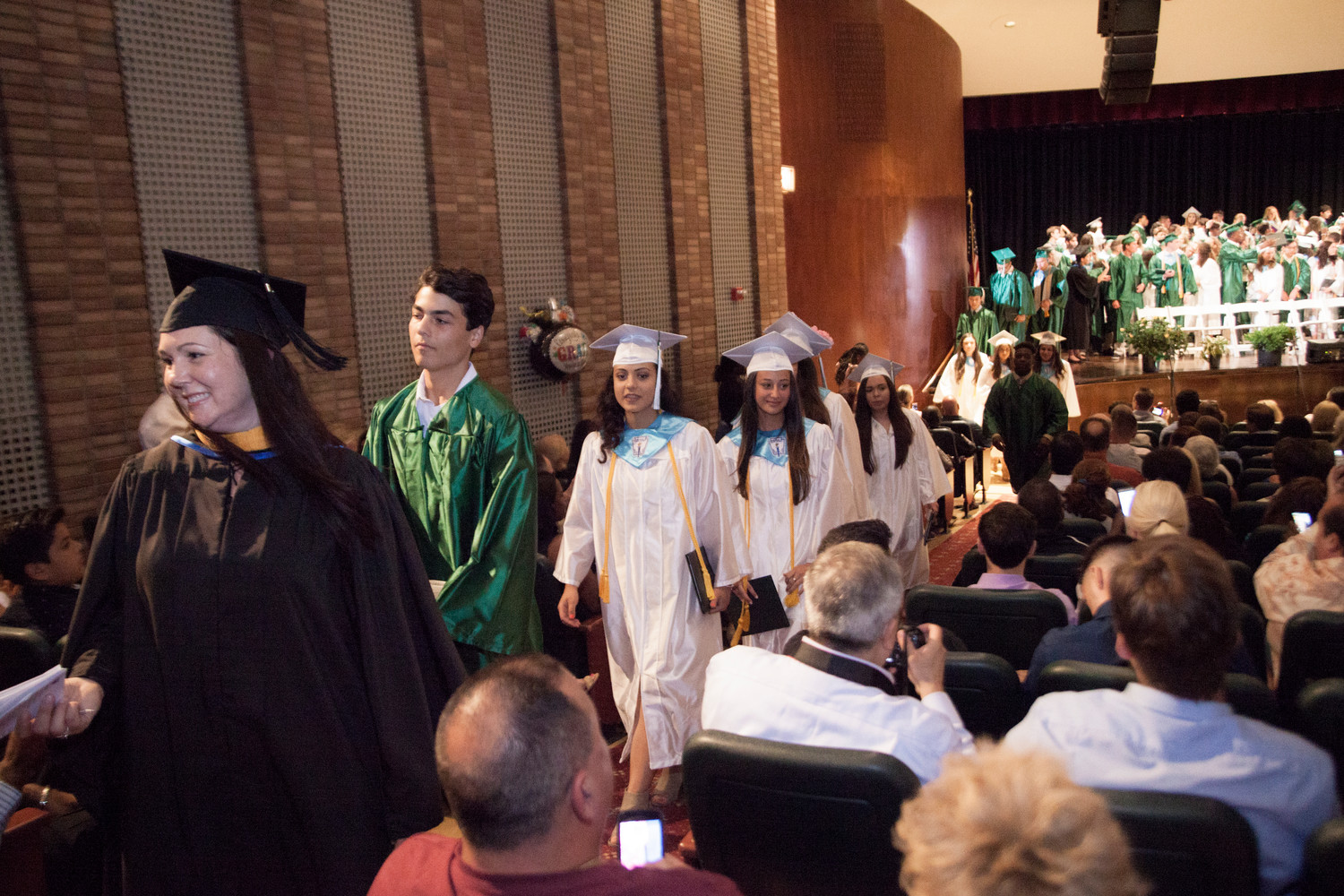 As the graduates exited the stage after the ceremony emotions ran high.
