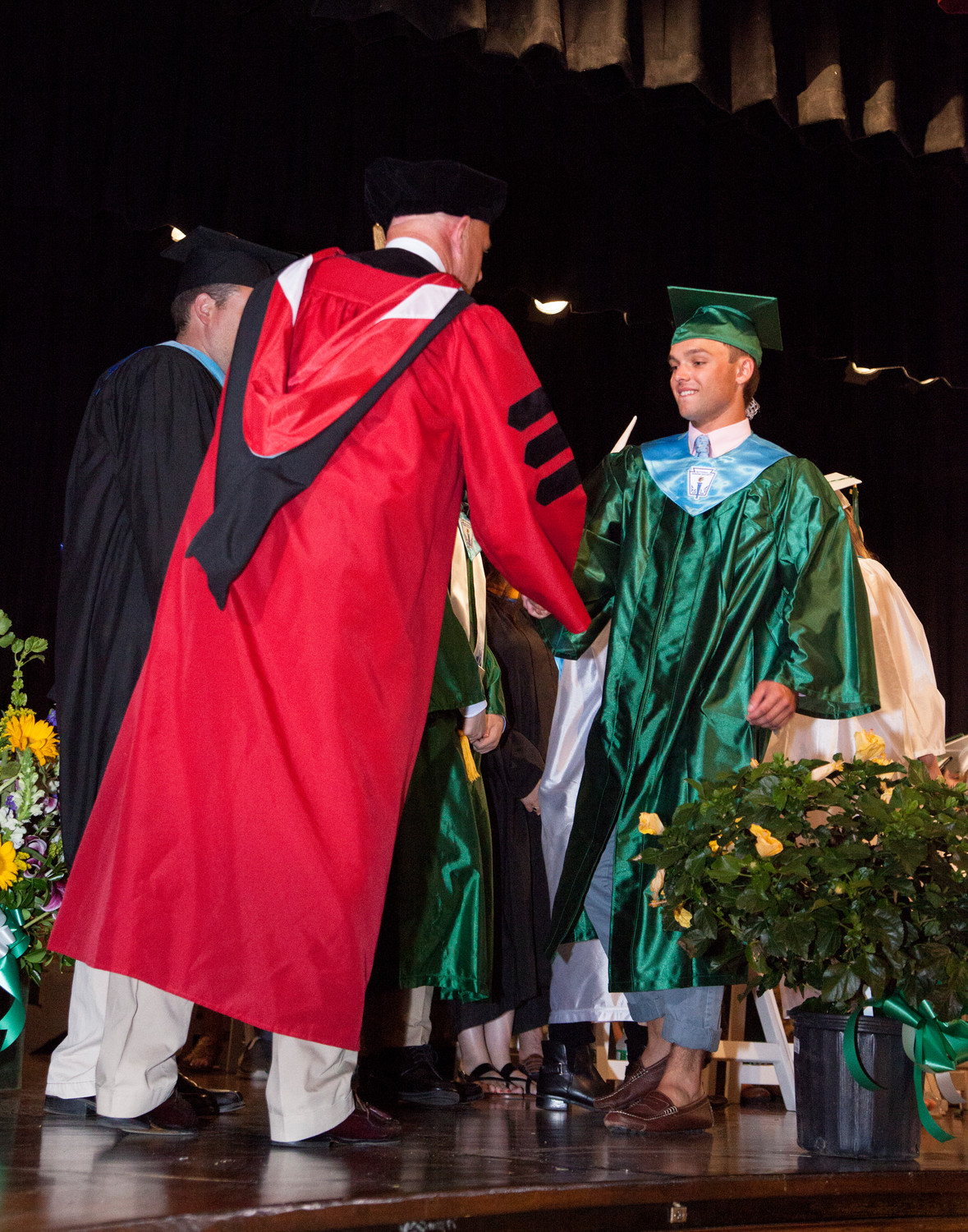 It was a proud day for all of the graduates, especially when they received their diploma, at left.