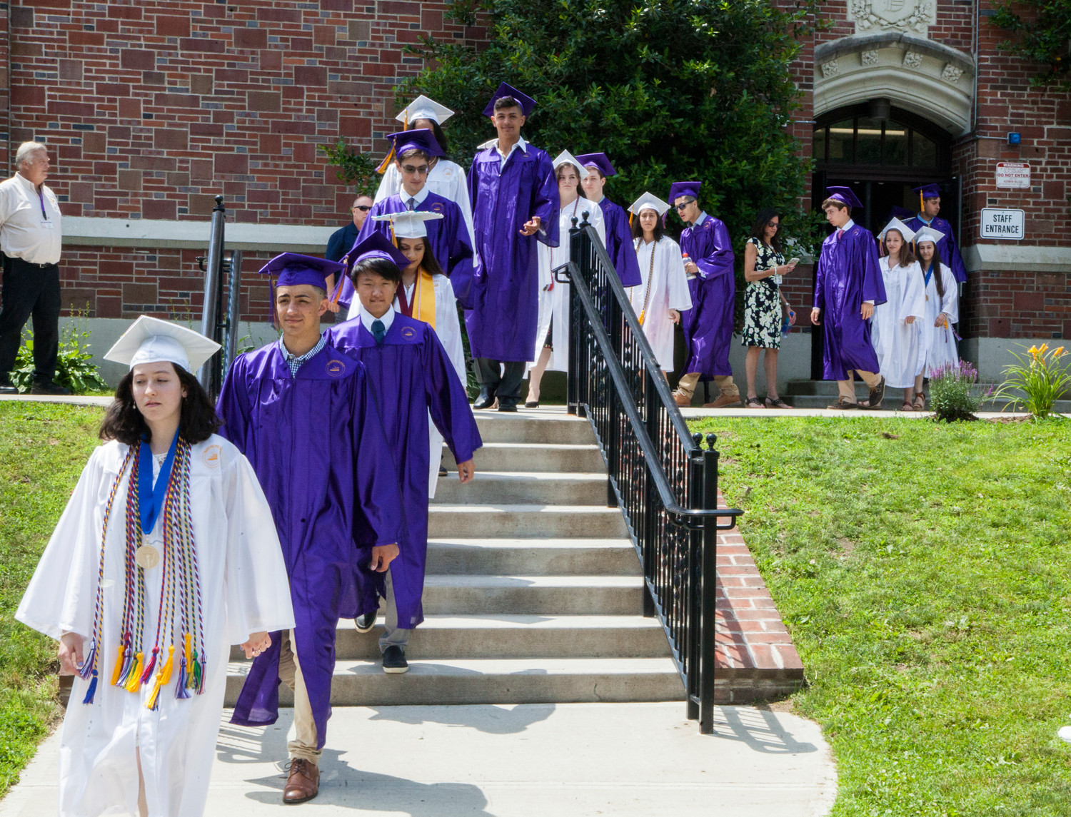 Some of the students graduating wore stoles to mark academic achievement.