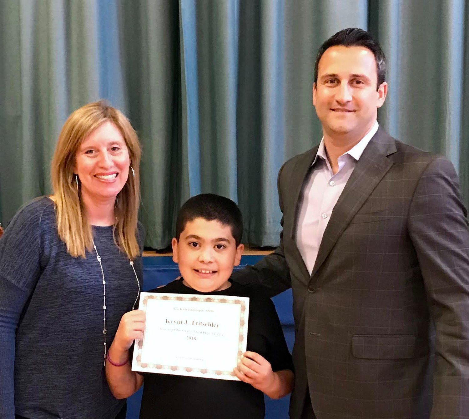 Kevin Tritschler is pictured with Challenge teacher Risa Miller, left, and Principle Rosario Iacono.