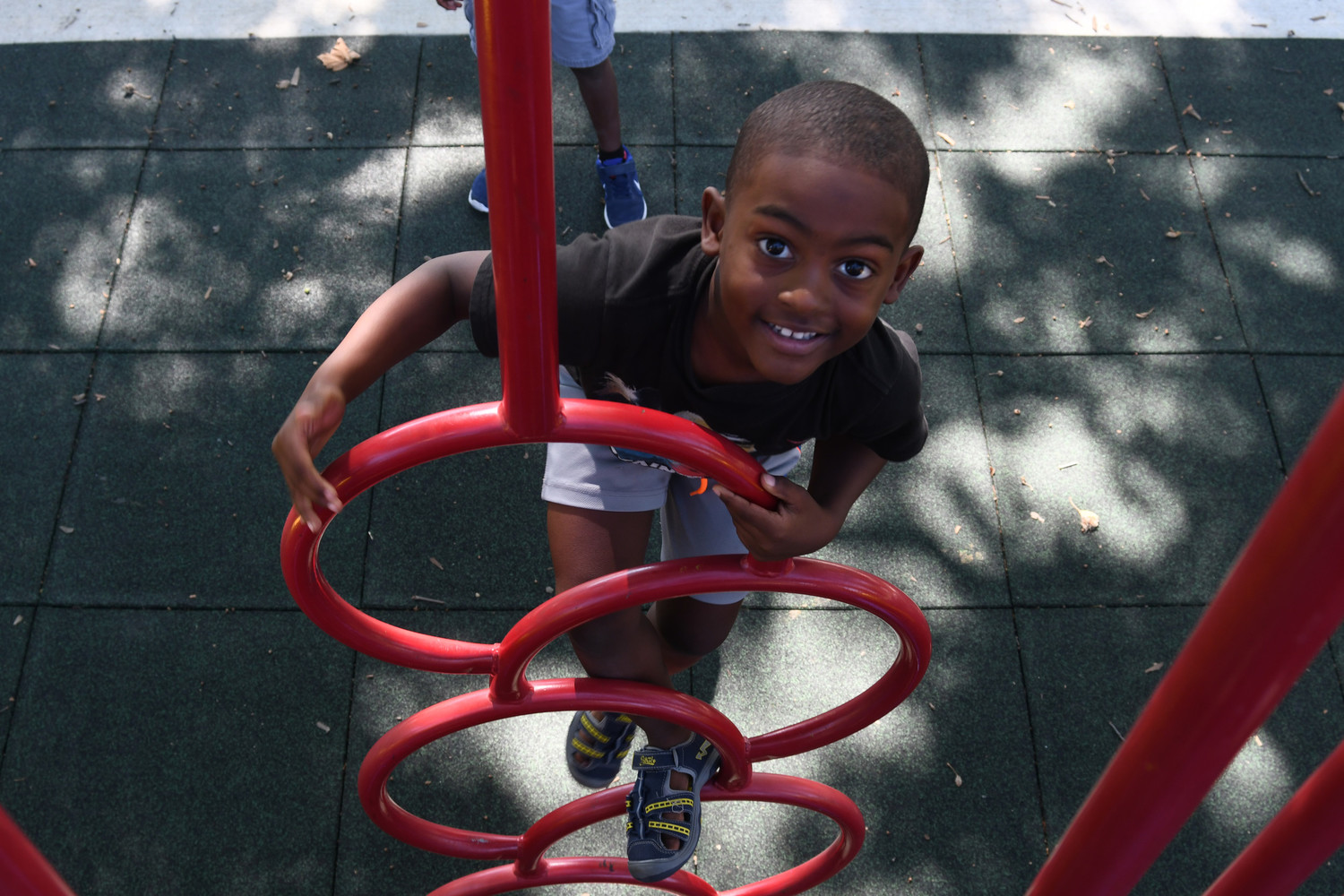 Kaleb Suchit, 5, helped break in a new playground at Greis Park when it opened last summer. Village officials are accepting bids for a master plan to redevelop the park.