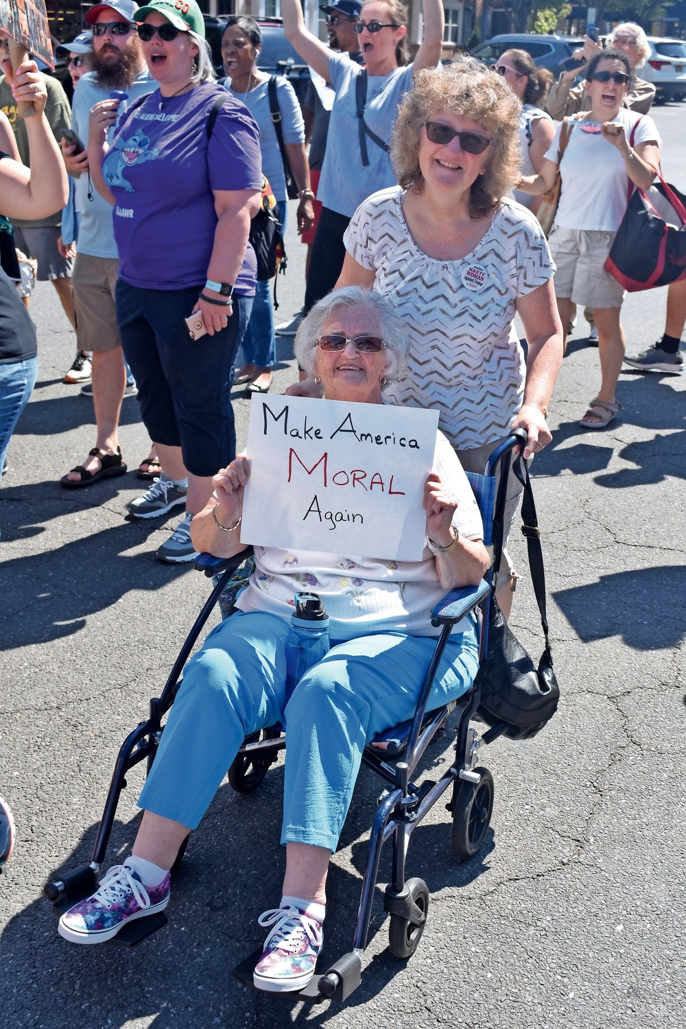 Marion Wright, with sign, of Baldwin, and Janet Moser, joined in the march.