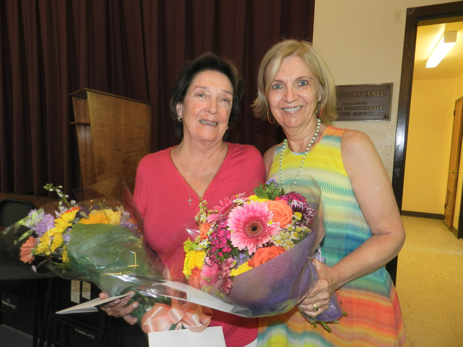 Outgoing lunch program director Janette Heurtley, left, and incoming director Jane McGilloway were surprised with flowers at Heurtley's retirement party.