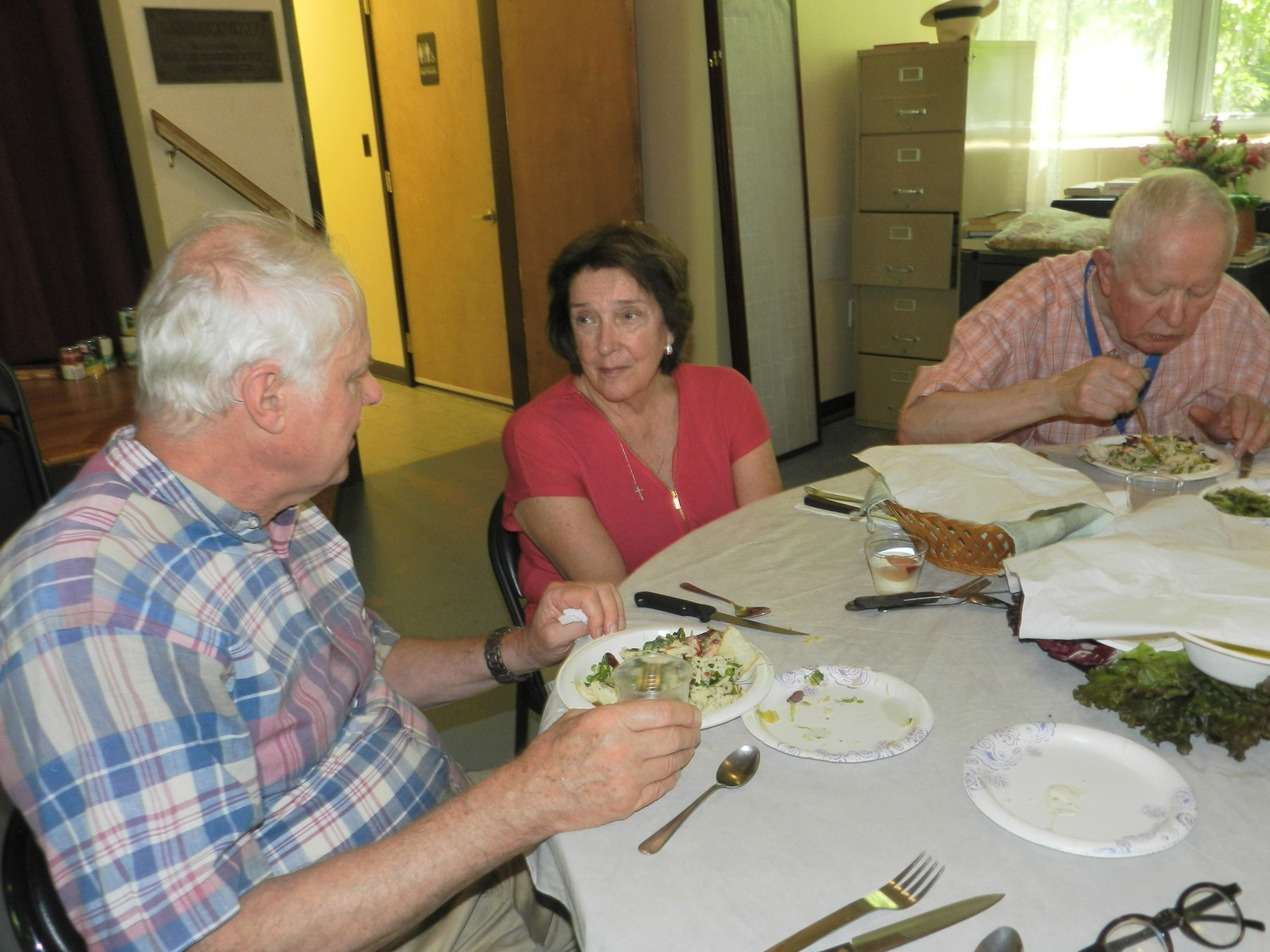 Despite retirement, Janette Heurtley joined lunching seniors Nigel Hawkins, left, and Roy Gustafson at their table to make sure the food and the service were up to par.