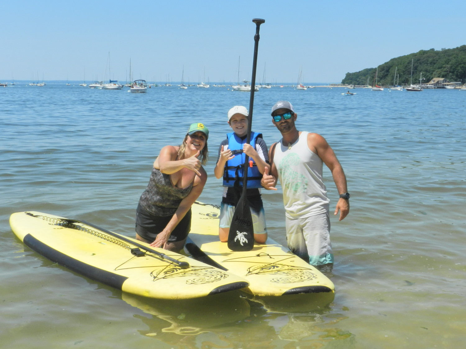 Linda Civigliano, StaS McClone, 12, and owner of Kostal Paddle, J.M. Kostaloas, were hanging loose in Hempstead Harbor while taking a ride on a pair of paddleboards.