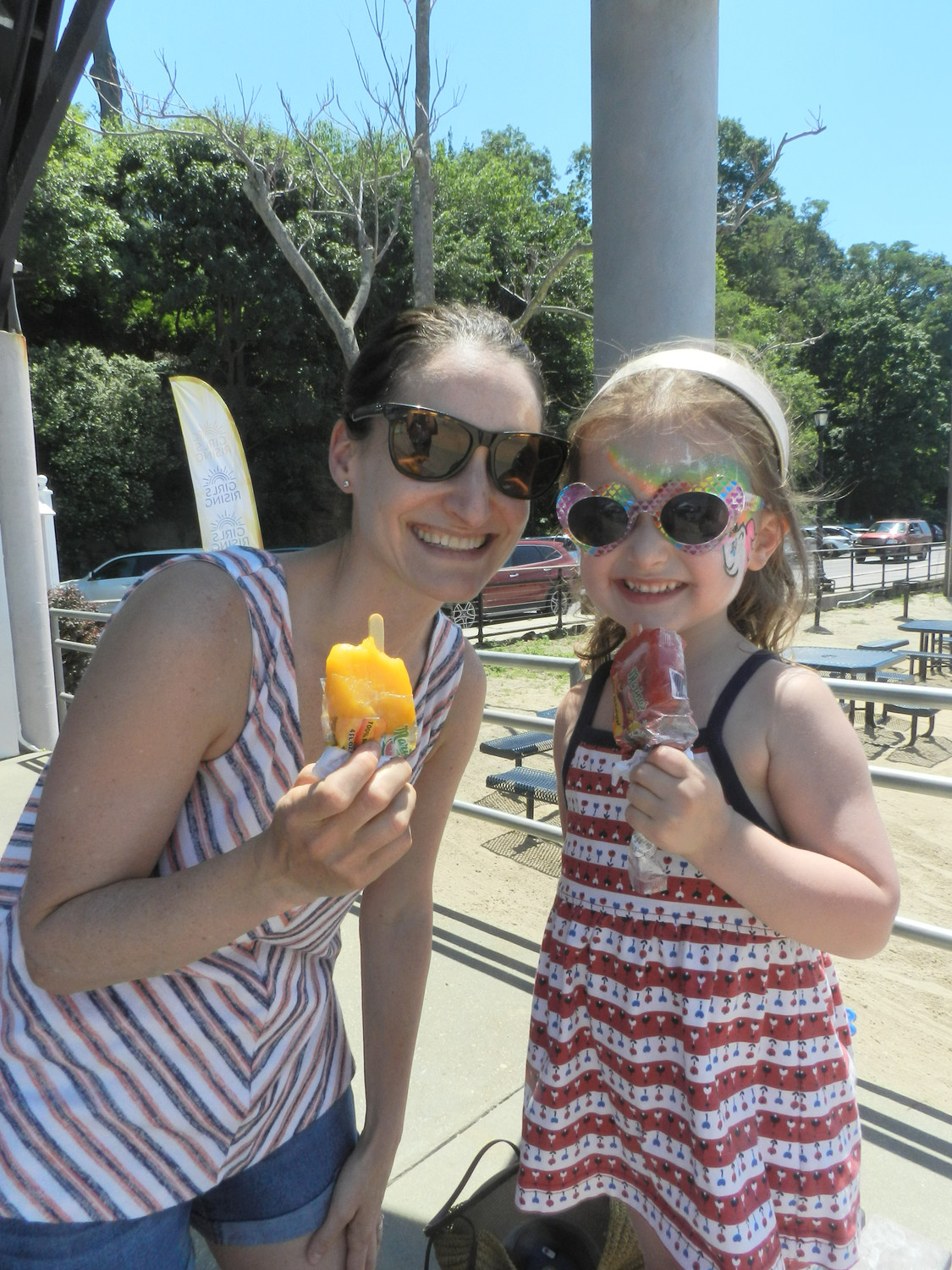 Suzanne Cohen and her daughter Bea, 4, beat the heat with frozen fruit bars.