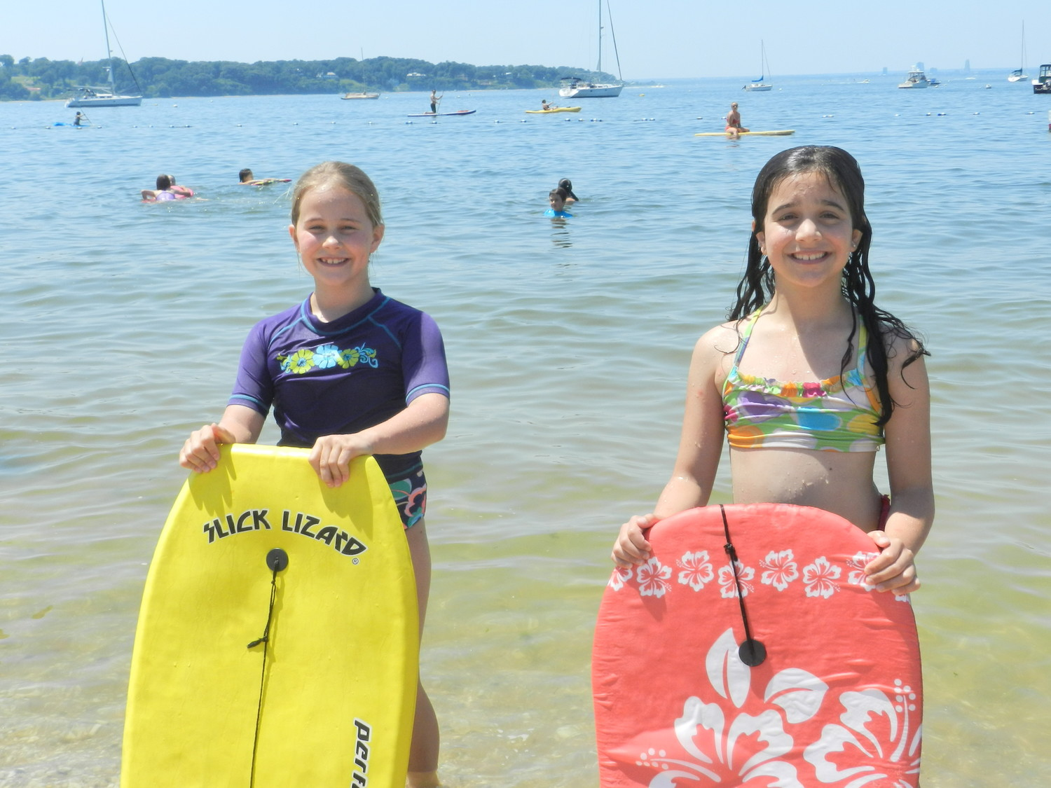 Lucy Sanborn, left, and Nicolletta Kenney, both 9, brought their boogie boards to BeachFest to catch some waves.