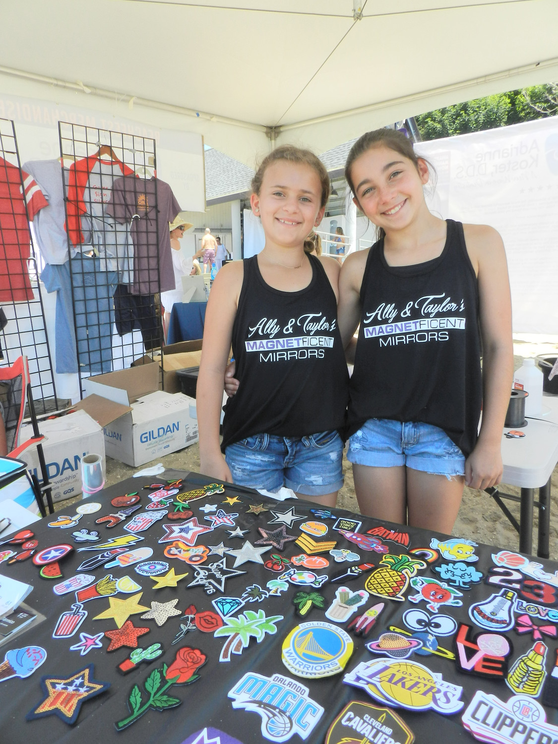 Ten-year-old entrepreneurs Taylor Silvia and Alexandra Basil brought their Magnetficent Mirrors to the beach.