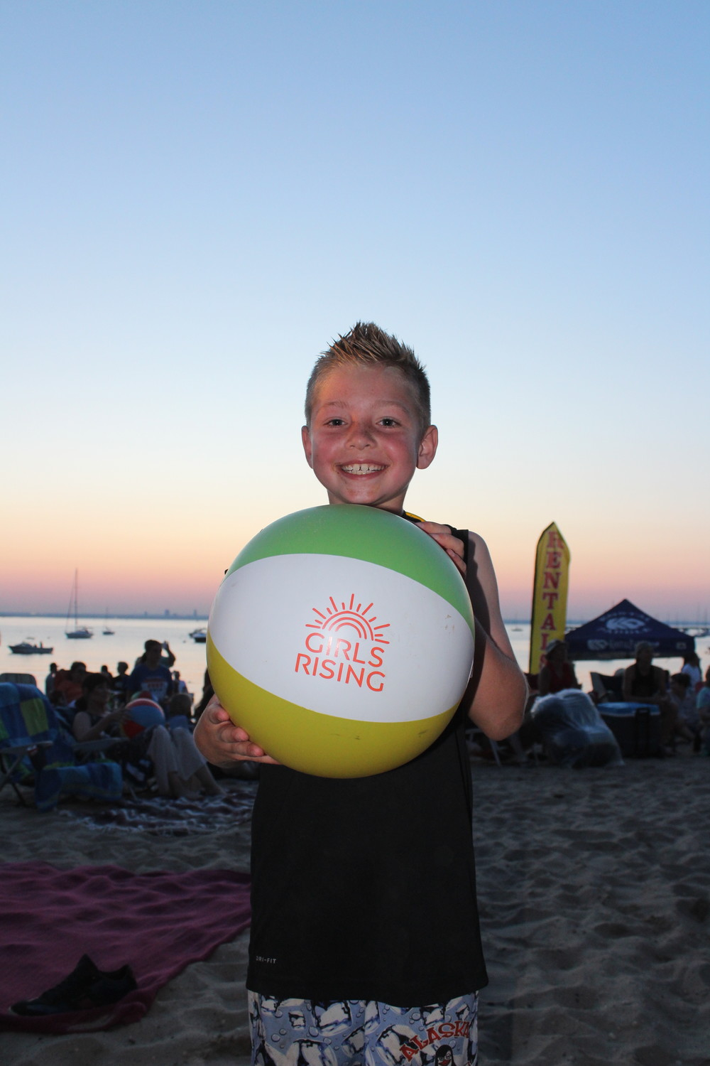 Jojo Basile, 9, played with a beach ball during the concert.