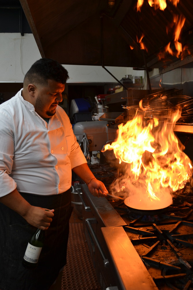 Chef Manny Benitez, owner of Vivo Osteria in Glen Cove, fired up a dish in the kitchen.