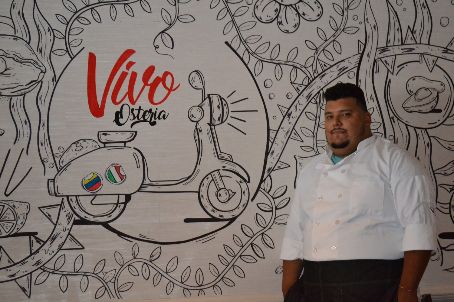 Chef Manny Benitez said that the mural in the restaurant, like the food it serves, mixes Italian and Latin American influences.