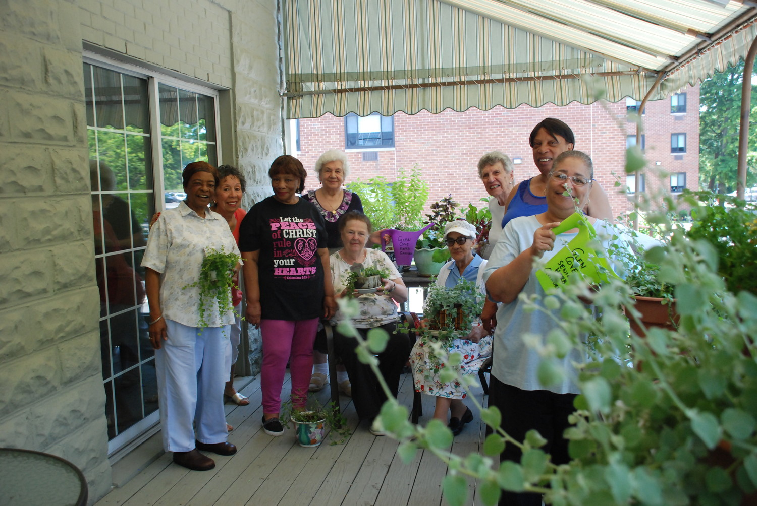 The Garden Committee at the Glen Cove Senior Center works hard to maintain the herbs and fragrant flowers on the center's back porch.