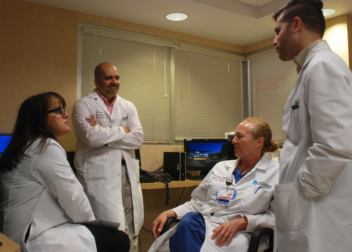 Dr. Carina Biggs, second from left, meeting with members of South Nassau's trauma team, including, from left, Margaret Puya, a nurse and the trauma program manager; Dr. Paul Grewal, the program's associate medical director; and Dr. Joshua Melanmed, a surgical resident.