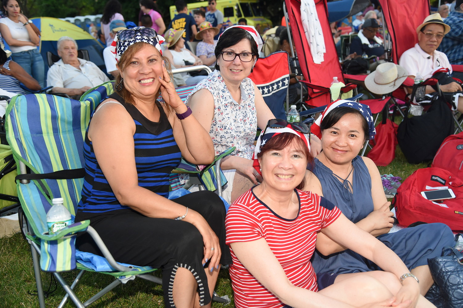 Francis Benitez, far left, Alice Arana, Alice Liu and Jennifer Ment, all of East Meadow, arrived at Eisenhower Park early to get a close view of the concert and fireworks.