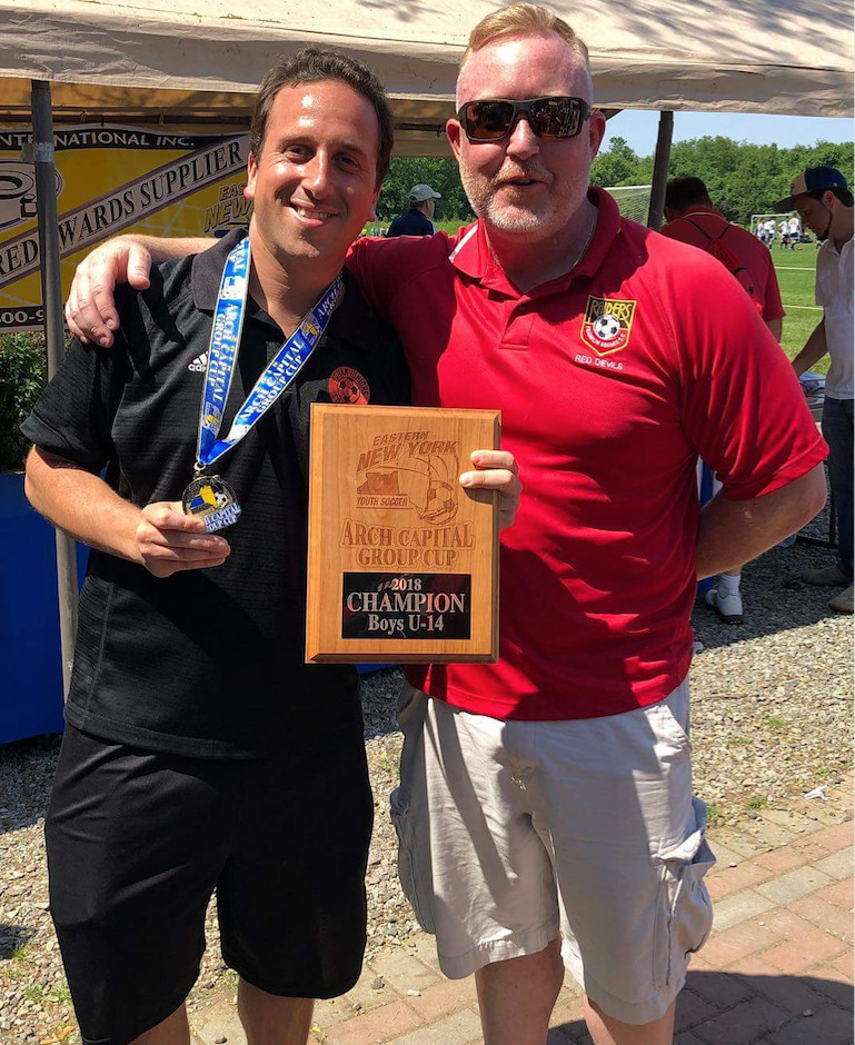 Coach Max Kimbarrow, left, and team manager Robert Gervasi. The Raiders' '04 Academy travel team triumphed 4-0.