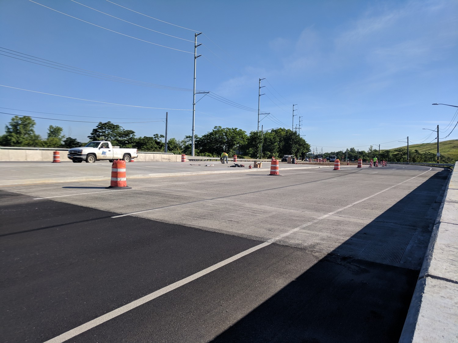 Workers put the finishing touches on the Barnum Island Bridge in Island Park hours before it's official completion on June 29. While one and sometimes two lanes were closed during construction, all three lanes going both ways are now open.