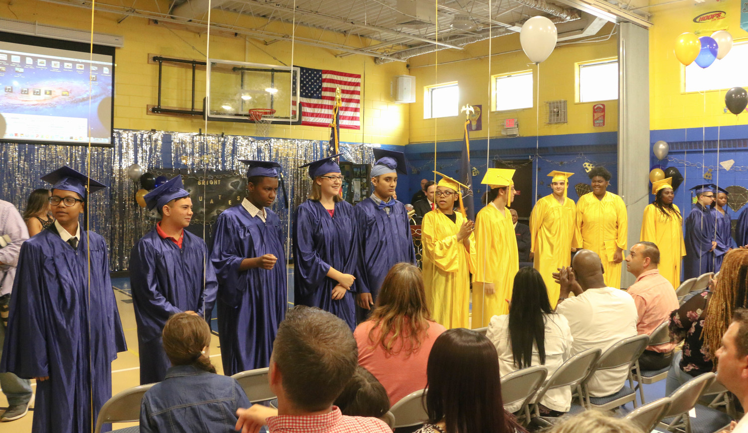 The of Woodward Children's Center Class of 2018 stood before their families, teachers, elected officials and school administrators and teachers on June 27 during their high school graduation at the school's gymnasium.