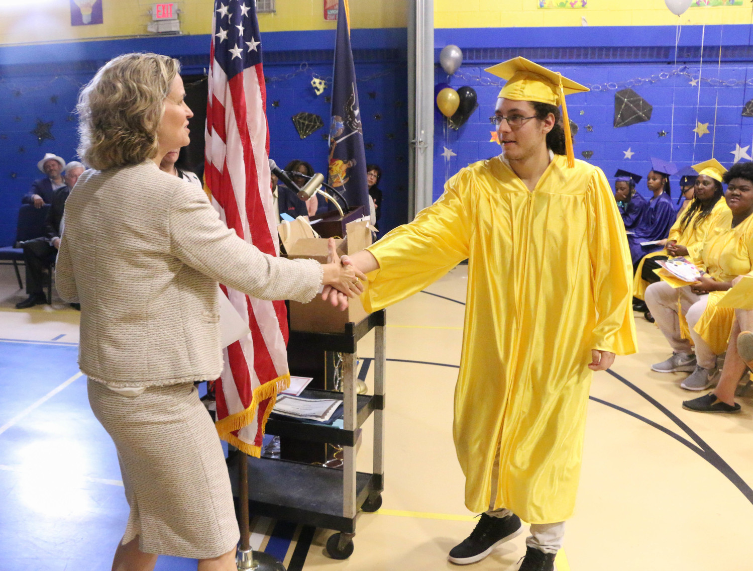 Nassau County Executive Laura Curran, right, handed Phillip Plangetis his high school diploma during the graduation ceremony.