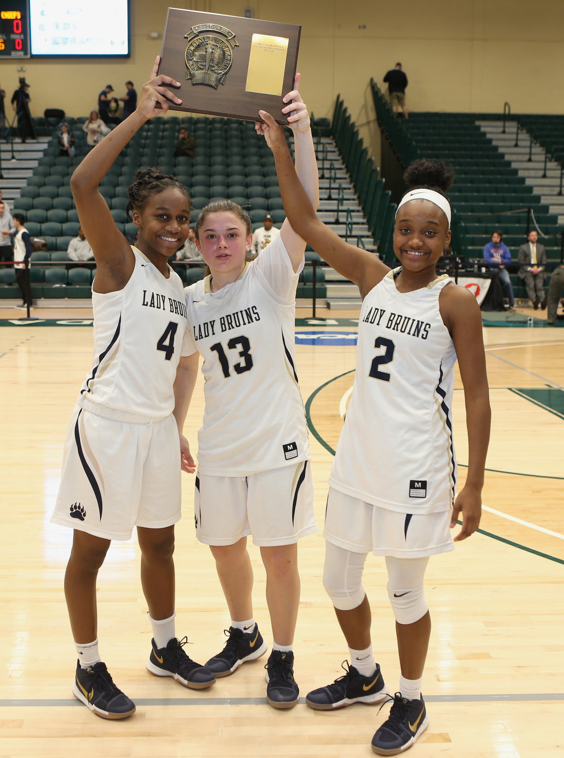 Baldwin captains, from left, Kaia Harrison, Jenna Annecchiarico and Aziah Hudson led the way to a 60-24 win over Massapequa as the Lady Bruins claimed a fifth straight Nassau Class AA championship. They went on to win their first-ever state Federation crown.