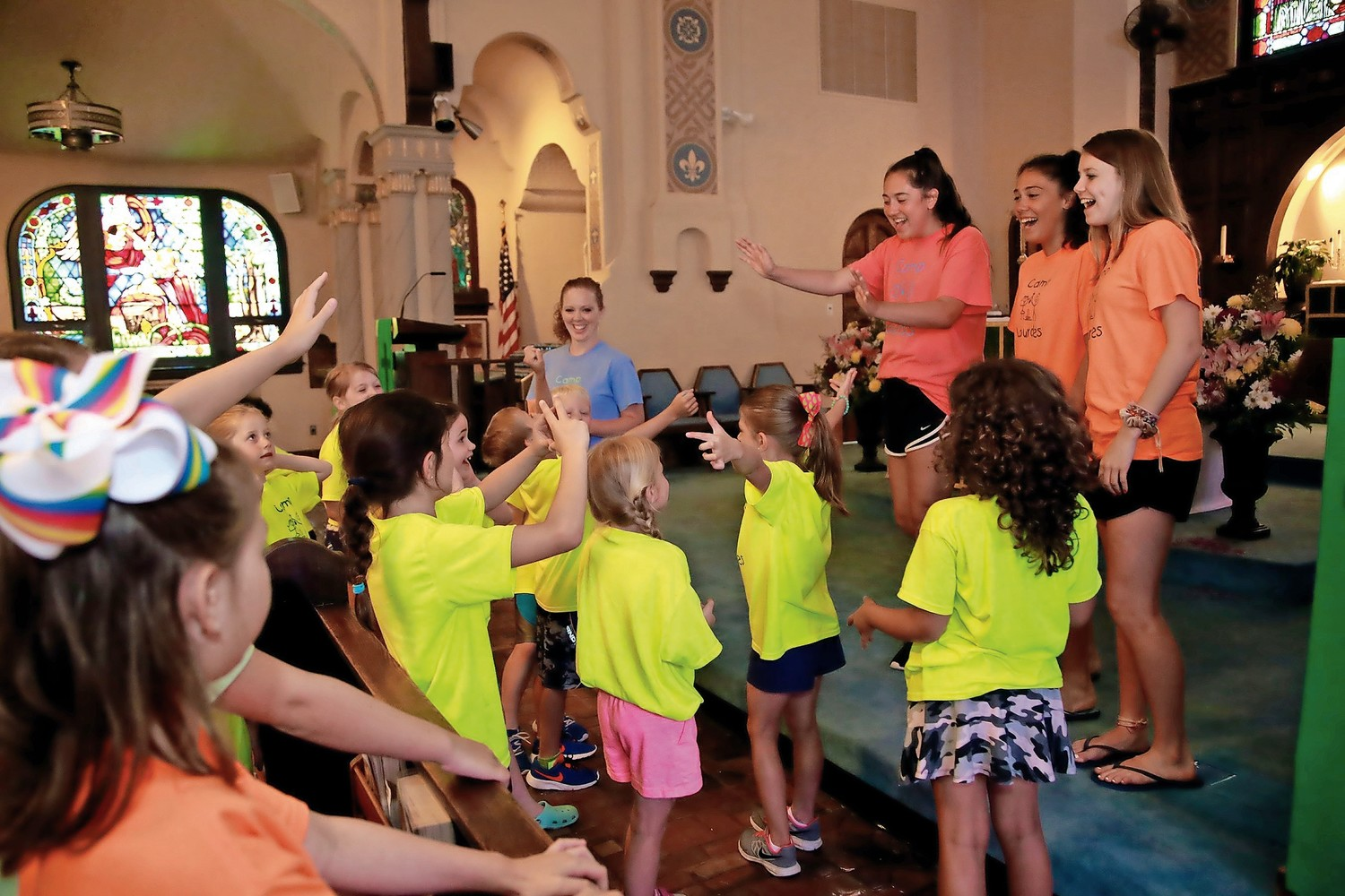 Counselors Ashley Grech, Sydney Aviles and Linda Freel led the campers during the music session.
