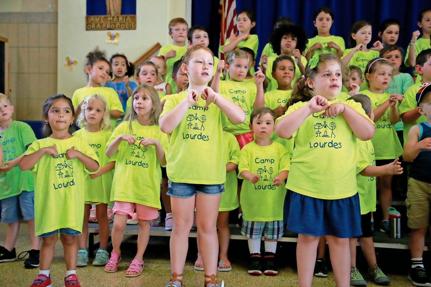 "Campers performed ""Go Save Our World."""