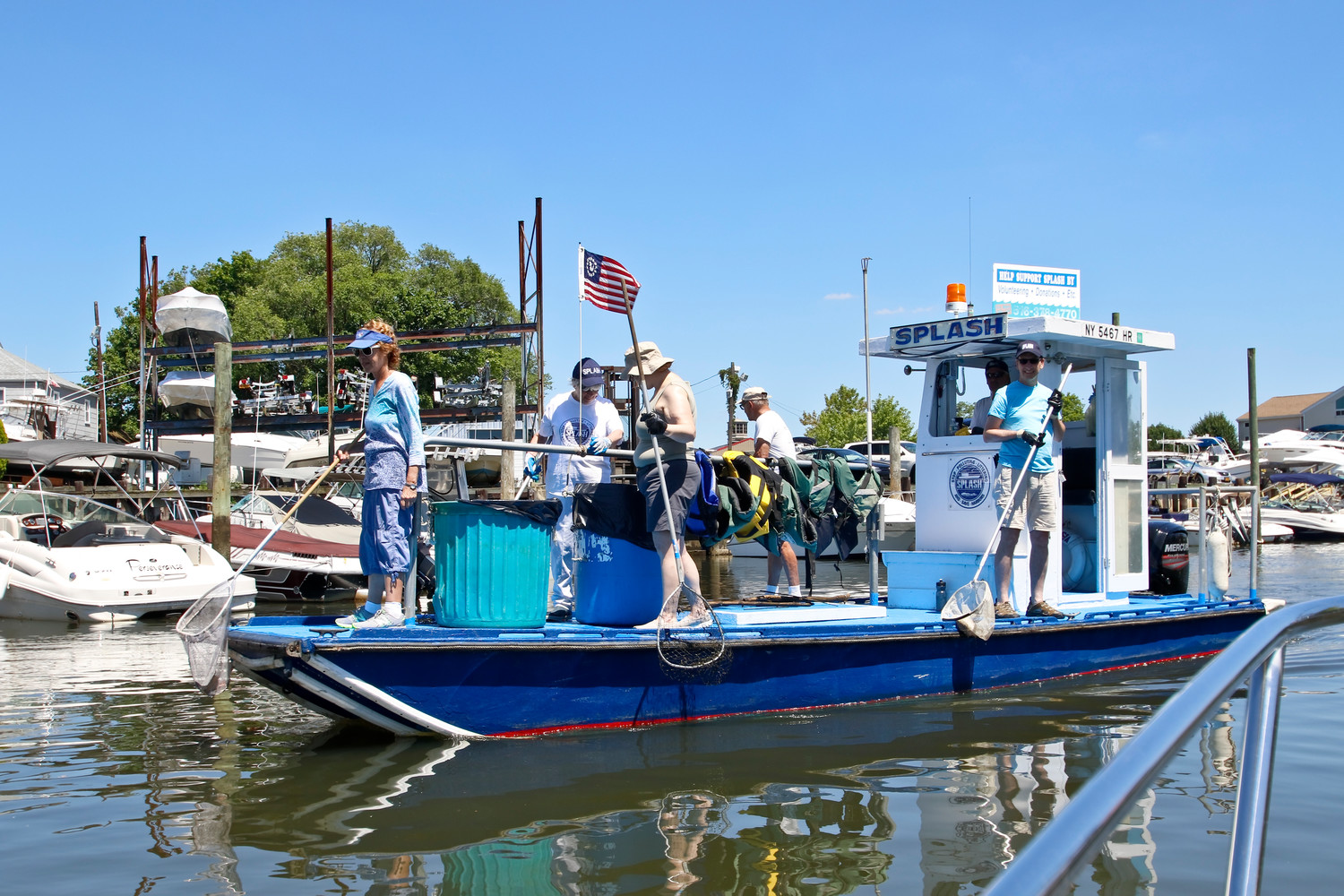Sonny's Canal House and Operation SPLASH partnered for the second year in a row to host a bay and canal cleanup in Baldwin Harbor. Last year they pulled out 1,500 pounds of garbage. This year they hauled out XXXX