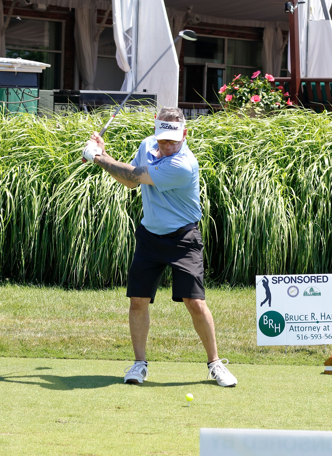 John Bua teed off at the first hole of the annual Mayor's Golf Outing on Monday at the Seawane Club in Hewlett Harbor. The event benefited former Lynbrook Police Inspector Ronald Fleury, who is battling amyotrophic lateral sclerosis.
