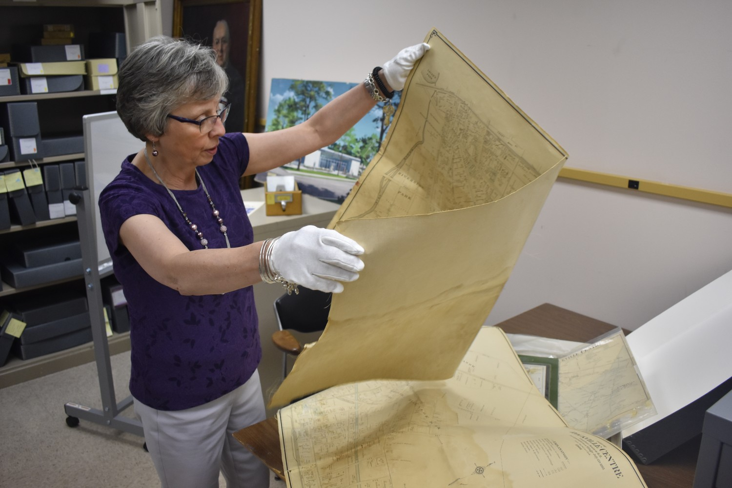 Alene Scoblete, the Rockville Centre Public Library's archivist and local history librarian, analyzed a 1906 map of Rockville Centre in the facility's basement.