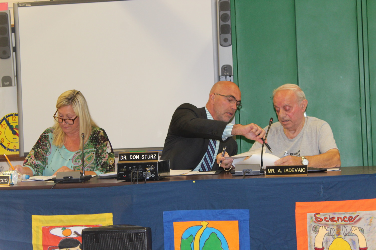 Donna LaRocco was elected school board president on Monday, despite Tony Iadevaio's claim that he should be the next president. Iadevaio is at right, along with Don Sturz, who was sworn in as the new superintendent.