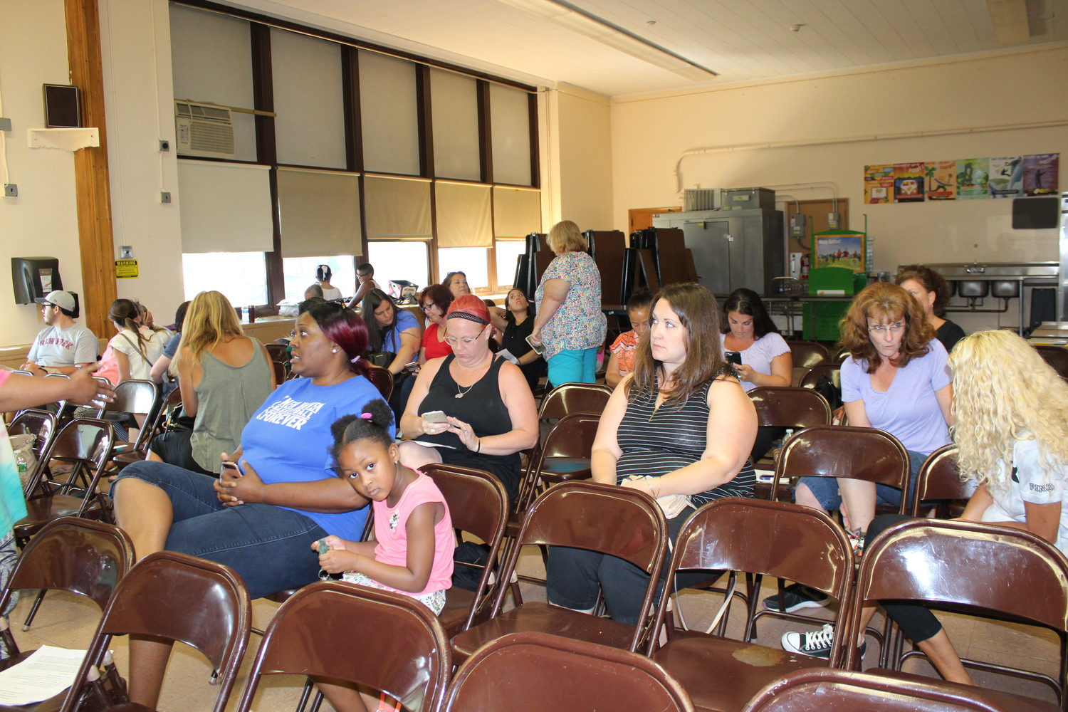 Residents waited almost an hour for District 24's Board of Education meeting to begin.